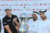 Stephen Gallacher (SCO) with Mohamed Juma Buamaim and Sheikh Hamdan Bin Mohammed Bin Rashid Al Maktoum after winning the tournament by 3 shots with a score  of -22 at the end of Sunday's Final Round of the 2013 Omega Dubai Desert Classic held at the Emirates Golf Club, Dubai, 3rd February 2013..Photo Eoin Clarke/www.golffile.ie