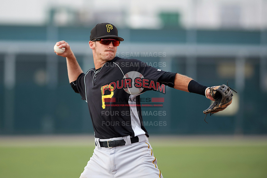 Pittsburgh Pirates third baseman Dylan Busby (54) warmup throw to first base during an Instructional League intrasquad black and gold game on September 28, 2017 at Pirate City in Bradenton, Florida.  (Mike Janes/Four Seam Images)