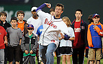 "April 13, 2009: Clemson head football coach Dabo Swinney throws out the ceremonial first pitch before Monday night's 2009 Greenville Drive opening game. Swinney said Clemson football player C.J. Spiller had sent him a text message before the game, imploring him ""Don't pull your hamstring"" when throwing the ball."