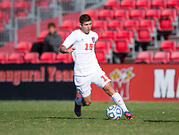 Alex Martinez (15) of North Carolina State brings the ball into the box during the game at Ludwig Field in College Park, MD. Virginia Tech defeated North Carolina State, 3-2, in the ACC tournament play-in game.