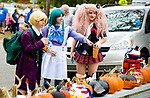 PROSPECT , CT-101417JS13-- Kaya Miller, 14, of Prospect, left, and her twin sister Katrina Miller, right, along with their friend Ellie Gamauf of Oxford, center, look over some of the decorated pumpkins on display during the 14th annual Prospect Pumpkin Festival on the green. The event is hosted by the Mayor's office and Parks and Recreation department.  Jim Shannon Republican-American