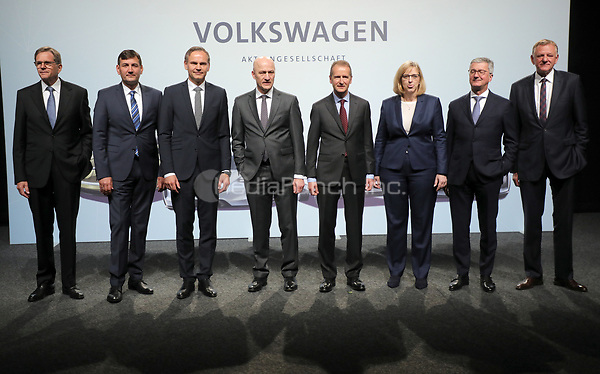 03 May 2018, Germany, Berlin: Board members of Volkswagen AG pose for photographers at the Volkswagen AG annual general meetingat the Messegelaende in Berlin: L-r: Jochem Heizmann, Gunnar Kilian, Oliver Blume, CEOof Porsche AG, Frank Witter, Herbert Diess, CEOof Volkswagen AG, Hiltrud Dorothea Werner, Rupert Stadler, Chairman of the Board of Management at Audi AG and Andreas Renschler. Photo: Wolfgang Kumm/dpa /MediaPunch ***FOR USA ONLY***