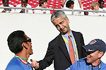 United States Soccer Federation president Sunil Gulati (center) talks with U-17 national team assistant coaches Raul Diaz Arce (l), of El Salvador, and Keith Fulk (r) on Sunday, March 25th, 2007 at Raymond James Stadium in Tampa, Florida. The United States Men's Under 17 National Team defeated El Salvador in a U-17 international friendly.