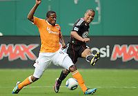 DC United forward Charlie Davies (9) goes against Houston Dynamo defender Jermaine Taylor (4)   Houston Dynamo tied DC United 2-2, at RFK Stadium, Saturday June 25, 2011.