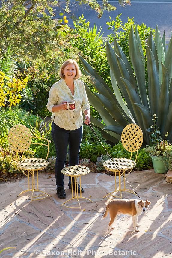 Debra Lee Baldwin with her dog 'Lucky' in her backyard garden