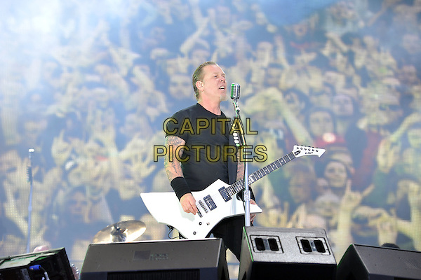 James Hetfield of Metallica .Performing live during Day 1 of Sonisphere festival, Knebworth House, England, UK, 8th July 2011..music live on stage gig concert half length black t-shirt playing guitar  wrist bands tattoos microphone .CAP/MAR.© Martin Harris/Capital Pictures.