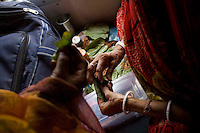 Sabitri Lakhera from Jabalpur (right) pack paan for friends and family in the group of 24 people travelling from Bhopal to Kanyakumari on the Himsagar Express 6318 on 9th July 2009.. .6318 / Himsagar Express, India's longest single train journey, spanning 3720 kms, going from the mountains (Hima) to the seas (Sagar), from Jammu and Kashmir state of the Indian Himalayas to Kanyakumari, which is the southern most tip of India...Photo by Suzanne Lee / for The National