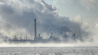 A mixture of steam and mist rise from the St. Clair River and Sarnia's industrial area.