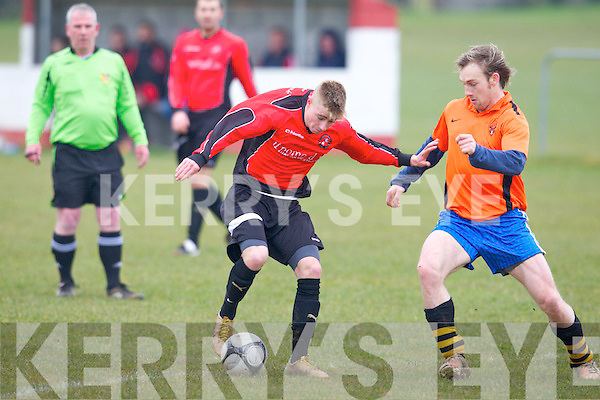 Tralee Dynamos Aaron Houlihan holds off the challenge of Annascual FC's Eamon Hickson in the Greyhoud Bar Cup at Cahermoneen, Tralee on Sunday.