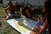 Chapada dos Guimaraes, Mato Grosso, Brazil. Liz Hosken, Mario Friedlander and Jorge looking at a map of Brazil; 1990.