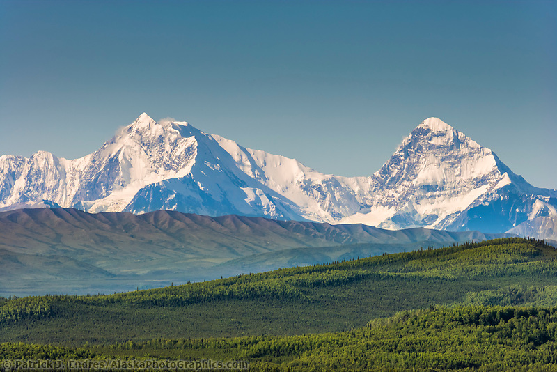 Mount Deborah and Mount Hess (right to left) of the Alaska range ridgeline viewed from a scenic viewpoint along the Richardson Highway, north of Delta Junction. Tanana river in the foreground of the mountain range.