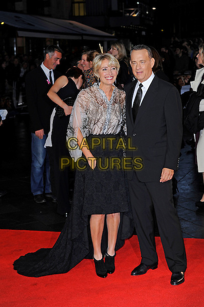 Emma Thompson and Tom Hanks<br /> attending the 57th BFI London Film Festival Closing Night Gala World Premiere of 'Saving Mr Banks', Odeon Cinema, Leicester Square, London, England. <br /> 20th October 2013<br /> full length black suit tie white shirt skirt train beige white pattern blouse top<br /> CAP/MAR<br /> &copy; Martin Harris/Capital Pictures