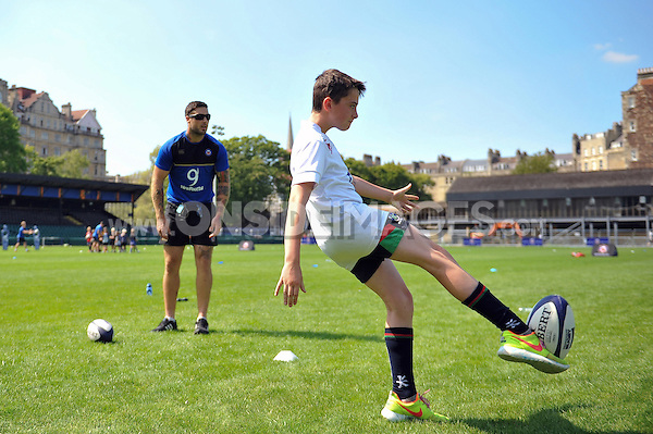 Matt Banahan of Bath Rugby runs a kicking clinic on the pitch. Bath Rugby Family Festival of Rugby, on August 8, 2015 at the Recreation Ground in Bath, England. Photo by: Patrick Khachfe / Onside Images