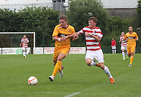 Shaun Hutchinson holds off James Martin in the Hamilton Academical v Motherwell friendly match played at New Douglas Park, Hamilton on 24.7.12..