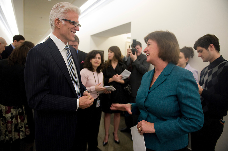 Actor Ted Danson talks with Rep. Carol Shea-Porter, D-N.H., in the Longworth House Office Building hallway outside of the House Natural Resources Committee hearing room on Wed. Feb. 11, 2009. Danson testified in the committee's hearing on offshore drilling.