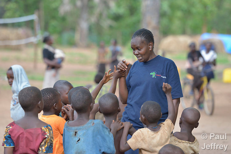 Josephine Murigi, a sister of Our Lady of the Missions and a member of Solidarity with South Sudan, talks with children in a camp for more than 5,000 displaced people in Riimenze, in South Sudan's Gbudwe State, what was formerly Western Equatoria. Families here were displaced at the beginning of 2017 as fighting between government soldiers and rebels escalated.<br /> <br /> Murigi, originally from Kenya, also provides pastoral accompaniment in the Riimenze parish, which has been overwhelmed with the displaced families. <br /> <br /> Solidarity with South Sudan is an international network of Catholic groups that provides training in South Sudan to teachers and health workers, as well as offering pastoral accompaniment to the people of the world's newest nation. Solidarity and Caritas Austria have both supported efforts by the diocese to ensure that the displaced families here have food, shelter and water.