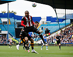 Leon Clarke of Sheffield Utd competes with Keiren Westwood of Sheffield Wednesday during the Championship match at the Hillsborough Stadium, Sheffield. Picture date 24th September 2017. Picture credit should read: Simon Bellis/Sportimage
