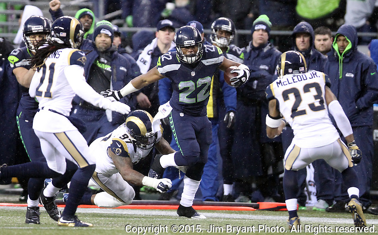 Seattle Seahawks running back Fred Jackson (22) runs after catching a pass against St. Louis Rams Janorius Jenkins (21), Rodney McLeod (23) and Eugene Sims (97)  at CenturyLink Field in Seattle, Washington on December 27, 2015.  The Rams beat the Seahawks 23-17.      ©2015. Jim Bryant Photo. All Rights Reserved