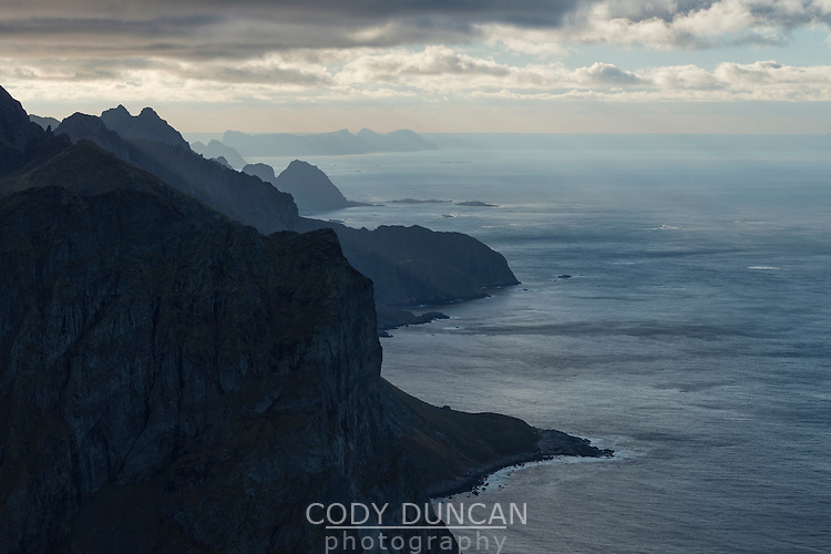 View over rugged northern coast of Moskenesøy from summit of Storskiva mountain peak, Lofoten Islands, Norway