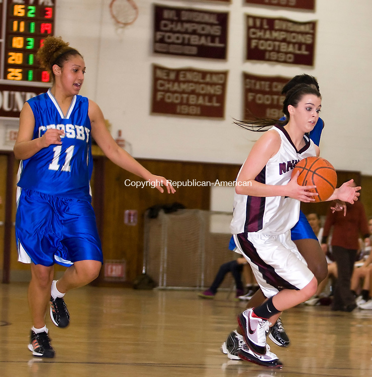 Naugatuck, CT-25, January 2010-012510CM07  Naugatuck's Julie Longo tries to elude Crosby defender Sara Guzman.  Longo scored 20 and helped defeat Crosby 61-36 Monday night in Naugatuck.  --Christopher Massa Republican-American