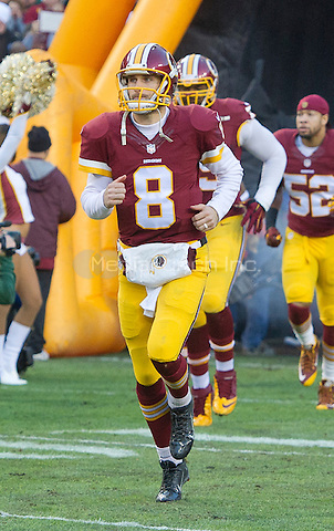 Washington Redskins quarterback Kirk Cousins (8) runs onto the field as his team is introduced prior to the NFC Wild Card game against the Green Bay Packers at FedEx Field in Landover, Maryland on Sunday, January 10, 2016.<br /> Credit: Ron Sachs / CNP/MediaPunch ***FOR EDITORIAL USE ONLY***