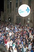 June 23 2002, Montreal, Quebec, Canada<br /> <br /> Quebecer of all origin , many of them displaying Quebec flags, take part in  the<br /> St Jean baptist ( Quebec national Holliday)<br />  Parade, June 23 2002 on Notre Dame Street in Montreal Canada.<br /> <br /> Festivities continue tomorrow June 24, which the actual date of the St Jean Baptiste.<br /> <br /> Mandatory Credit: Photo by Pierre Roussel- Images Distribution. (©) Copyright 2002 by Pierre Roussel <br /> <br /> NOTE :l Nikon D-1 jpeg opened with Qimage icc profile, saved in Adobe 1998 RGB.<br /> This photo is also available in the original size, with less compression (TIFF or JPEG 12)