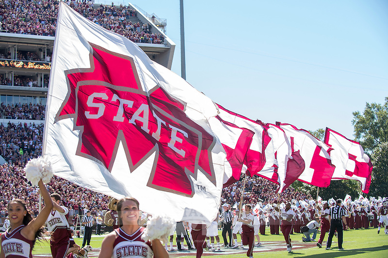Cheerleaders running on to the field with state flags during pregame vs Texas A&M. (photo by Beth Wynn / © Mississippi State University)