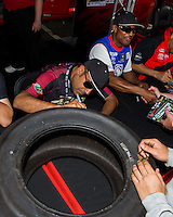May 30, 2014; Englishtown, NJ, USA; NHRA top fuel driver Khalid Albalooshi signing a tire at an autograph session during qualifying for the Summernationals at Raceway Park. Mandatory Credit: Mark J. Rebilas-