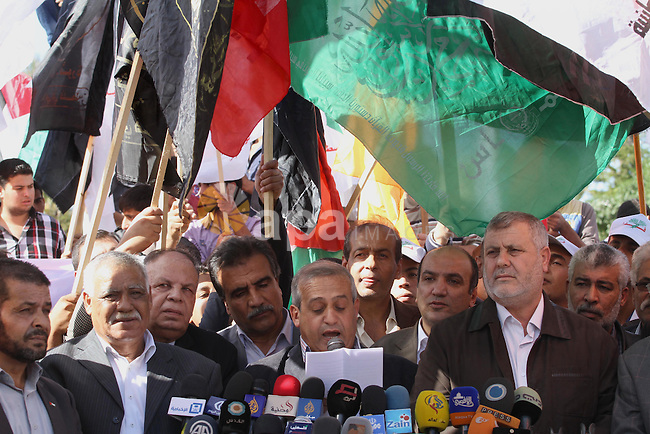 Members of the Palestinian factions hold national flags as they take part a demonstration to show solidarity with Jerusalem and against the recent visits by Jewish activists to al-Aqsa mosque, in Gaza city November 9, 2014. In recent weeks there have been near-daily clashes between the stone-throwing Palestinians and Israeli riot police in occupied East Jerusalem. Some of the attacks have turned deadly. The unrest was triggered by Muslim fears of Jewish encroachment at the sacred site, a hilltop plateau known to Muslims as Haram as-Sharif, or Noble Sanctuary, and to Jews as the Temple Mount. Photo by Mohammed Asad