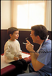 doctor examining young boy