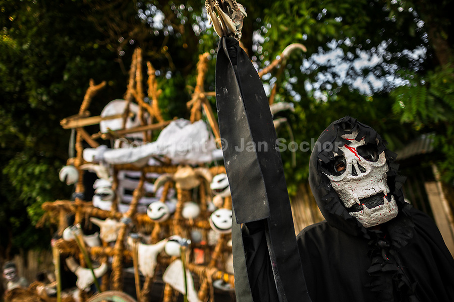A young Salvadoran man, wearing a Grim Reaper mask, performs during the La Calabiuza parade at the Day of the Dead celebration in Tonacatepeque, El Salvador, 1 November 2016. The festival, known as La Calabiuza since the 90s of the last century, joins Salvador's pre-Hispanic heritage and the mythological figures (La Sihuanaba, El Cipitío, La Llorona etc.) collected from the whole Central American region, together with the catholic All Saints Day holiday and its tradition of honoring the dead relatives. Children and youths only, dressed up in scary costumes and carrying painted carts, march from the local cemetery to the downtown plaza where the party culminates with music, dance, drinking and eating pumpkin (Ayote) with honey.