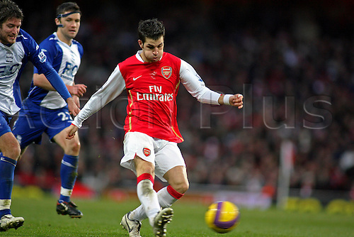 12 January 2008: Arsenal midfielder Cesc Fabregas passes the ball during the Premier League game between Arsenal and Birmingham City played at the Emirates Stadium. The game finished 1-1. Photo: actionplus...football soccer 080112 player pass