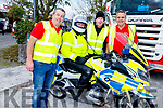 Eamon O'Connell, Gerard Doyle, Mike Baker and Gda Brian Hayles, on his motorbike at the Abbeydorney Vintage Society Charity Truck Run in aid of Childline on Sunday