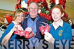 MEMORY MAKERS: Students from Mercy Mounthawk Secondary school helped with the Rotary Club Christmas Memory Tree in Manor this week. From l-r were: Eve Heim, John Doyle (Tralee Rotary Club) and Jennifer Locke.    Copyright Kerry's Eye 2008