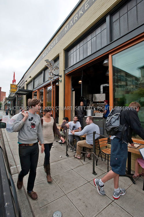 """7/31/2010--Seattle, WA, USA..The Melrose Market, a new marketplace located in two refurbished historic buildings in Seattle's fashionable Capitol Hill neighborhood. Co-developers Scott Shapiro, of Eagle Rock Ventures, and Liz Dunn, of Dunn & Hobbs, purchased the buildings -- two former automotive shops built in 1919 and 1925 -- in the fall of 2008 with plans to renovate...Stores inside lean towards local and sustainable foods. Stores inside include:..Rain Shadow Meats: One of the best food trends to hit Seattle in recent years: charcuterie. With pork terrine and confit duck gizzards. www.rainshadowmeats.com...Sitka & Spruce, the big draw now at Melrose Market. www.sitkaandspruce.com...Marigold and Mint: Flowers out of its organic farm in Snoqualmie Valley. Edible flowers included. www.marigoldandmint.com...bar ferd'nand: A full-service bar and wine shop, featuring local, organic and biodynamic wines, most sold for $10-$25. www.ferdinandthebar.com...The Calf & Kid: Features gourmet cheese from Europe and also from local artisanal cheesemakers, including Gothberg Farms, which makes some underrated goat cheese in the Bow and Edison area, and Kurtwood Farms on Vashon Island. http://calfandkid.blogspot.com...Homegrown Sustainable Sandwich Shop: Offers sidewalk seating with seven tables. Also serves beer. Will soon be open on Fridays and Saturdays until 3 a.m. âEUR"""" with a deep-fried marshmallow, bacon and peanut butter sandwich. www.eathomegrown.com...Still Liquor. Located on the back of the market. Everyone thought it was a speakeasy-style bar. Turns out the guys never got around to putting up a sign until recently. www.stillliquor.com...Sonic Boom Records. Used record and CD store with a stage to host live music...Velouria Boutique. A boutique and gallery featuring local artists and designers. http://velouriaboutique.blogspot.com...©2010 Stuart Isett. All rights reserved."""