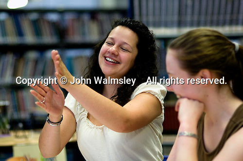 Music teacher explaininging a movement to a 6th Former. State Secondary Roman Catholic school.