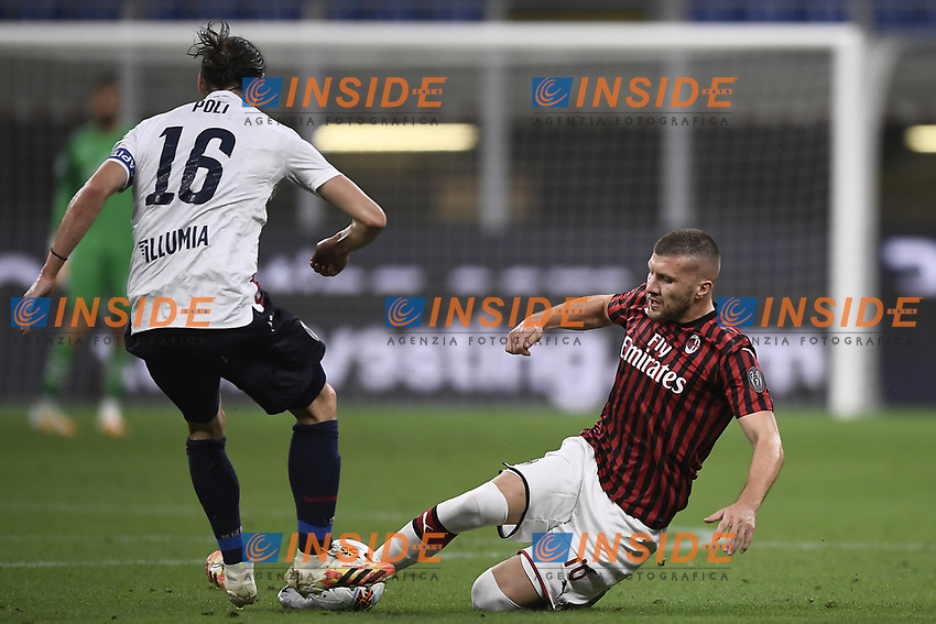 Andrea Poli of Bologna FC and Ante Rebic of AC Milan compete for the ball during the Serie A football match between AC Milan and Bologna FC at stadio Giuseppe Meazza in Milano ( Italy ), July 18th, 2020. Play resumes behind closed doors following the outbreak of the coronavirus disease. <br /> Photo Image Sport / Insidefoto
