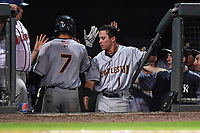 Shortstop Diego Castillo (7) of the Charleston RiverDogs is greeted by teammates after scoring a run in Game 2 of the South Atlantic League Southern Division Playoff against the Greenville Drive on Friday, September 8, 2017, at Fluor Field at the West End in Greenville, South Carolina. Charleston won, 2-1, and the series is tied at one game each. (Tom Priddy/Four Seam Images)