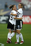1 August 2003: Mary-Frances Monroe (19) and Kristine Lilly (13) celebrate Lilly's goal in the second minute of play. The Boston Breakers defeated the New York Power 3-2 at Mitchel Field in Uniondale, NY in a regular season WUSA game..Mandatory Credit: Scott Bales/Icon SMI