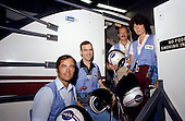 Four-fifths of the STS-7 crew take a break from simulations in the Johnson Space Center's Mission Simulation and Training Facility and pose for NASA photographer on May 23, 1983. Standing on the steps leading into the motion-based Shuttle Mission Simulator (SMS) are (left to right) astronauts Robert L. Crippen, John M. Fabian, Frederick H. Hauck and Sally K. Ride. Crippen is crew commander; Hauck, pilot; and Fabian and Dr. Ride are mission specialists, along with Dr. Norman E. Thagard (not involved in this phase of training and not pictured).  Dr. Ride passed away due to Pancreatic Cancer on Monday, July 23, 2012..Credit: NASA via CNP