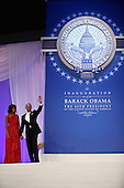 United States President Barack Obama and first lady Michelle Obama wave goodbye after attending the Inaugural Ball at the Walter Washington Convention Center January 21, 2013 in Washington, DC. President Obama started his second term by taking the Oath of Office earlier in the day during a ceremony on the West Front of the U.S. Capitol..Credit: Chip Somodevilla / Pool via CNP