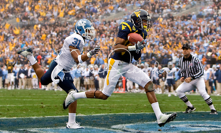 North Carolina safety Trimane Goddard (31) chases after a West Virginia player during the Meineke Car Care Bowl college football game at Bank of America Stadium in Charlotte, NC.