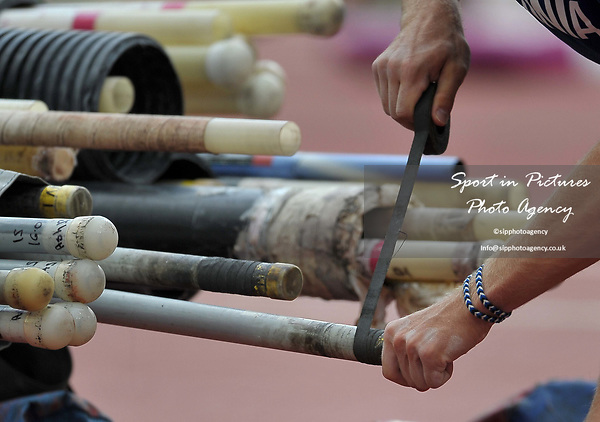 Getting the tape readyon the poles in the mens decathlon pole vault. IAAF world athletics championships. London Olympic stadium. Queen Elizabeth Olympic park. Stratford. London. UK. 12/08/2017. ~ MANDATORY CREDIT Garry Bowden/SIPPA - NO UNAUTHORISED USE - +44 7837 394578
