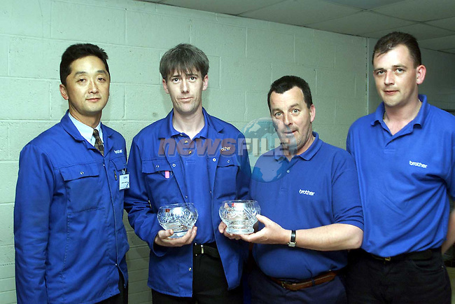 Junichi Maeda, Liam Flood, Johnny Kelly and Alan McCullen who recieved 10 year service awards from Brother..Picture Paul Mohan Newsfiloe