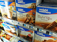 Weight Watchers brand ice cream in a supermarket freezer in New York on Thursday, March 17, 2016. Despite the affiliation with Oprah Winfrey Weight Watchers stock is down 40% this year as consumers show little interest in the brand. (© Richard B. Levine)