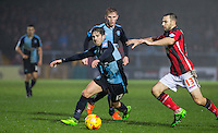 Max Kretzschmar of Wycombe Wanderers fights off Alan Goodall of Morecambe during the Sky Bet League 2 match between Wycombe Wanderers and Morecambe at Adams Park, High Wycombe, England on 2 January 2016. Photo by Andy Rowland / PRiME Media Images