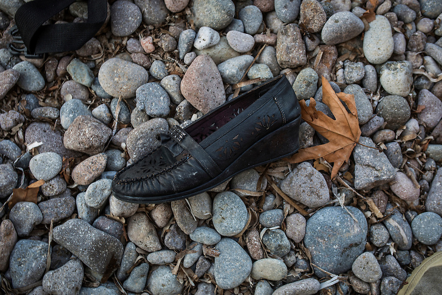 A woman's shoe left on the beach at Skala Sikamias, on the island of Lesbos, Greece, where thousands of immigrants have been landing daily.