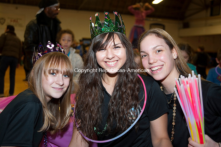 TORRINGTON, CT-123113JS11- Members of the Mayor's Committee on Youth, Olivia Lemieux, 14, Erica Morrison, 14, and Mia Barbieri, 16, at  Last Night New Years Eve celebration at the Torrington Armory in Torrington. <br /> Jim Shannon Republican-American