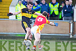 Ambrose O'Donovan, Dr. Crokes in action against Barry Moran, in the All Ireland Senior Club Semi Final at Portlaoise on Saturday.