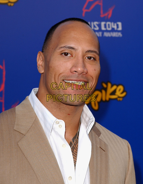 "DWAYNE ""THE ROCK"" JOHNSON.The 4th Annual Taurus World Stunt Awards held at The Paramount Picture Studios in Los Angeles California .May 16,2004.headshot, portrait, tattoo.www.capitalpictures.com.sales@capitalpictures.com.©Capital Pictures"